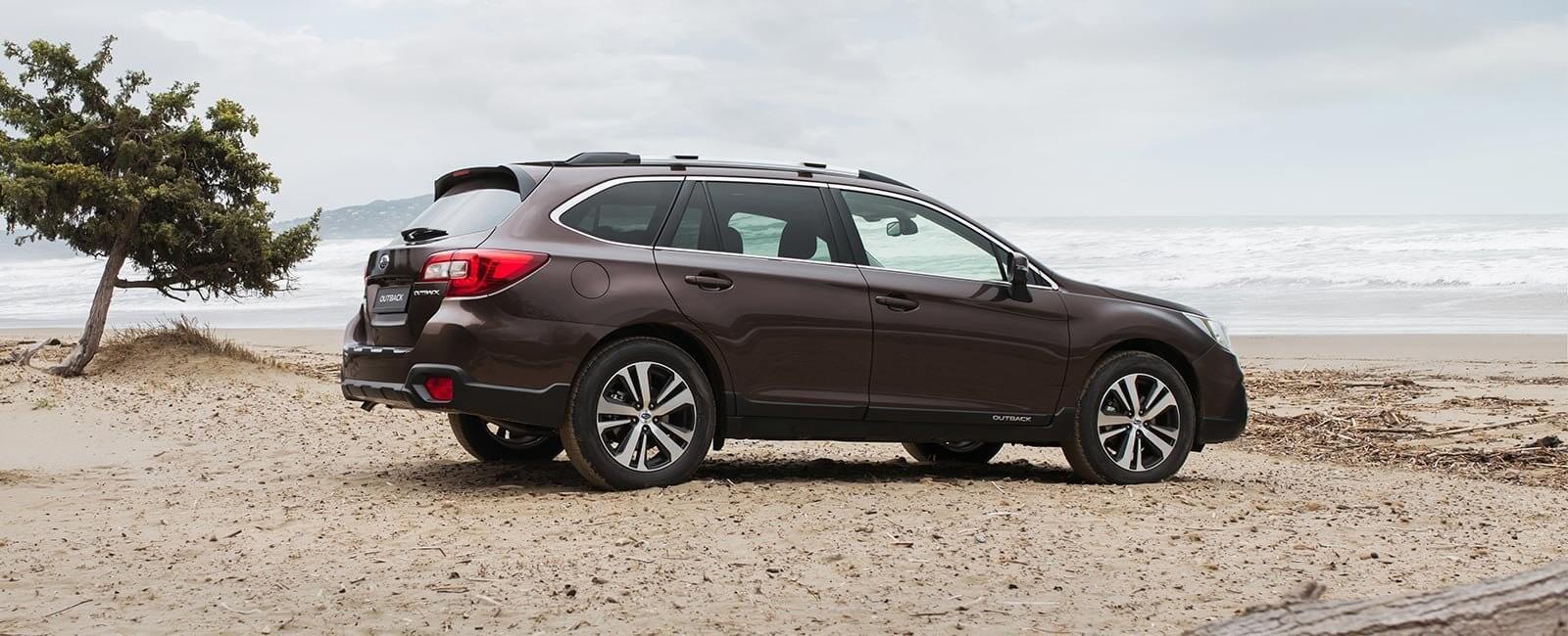 Subaru Outback på stranda